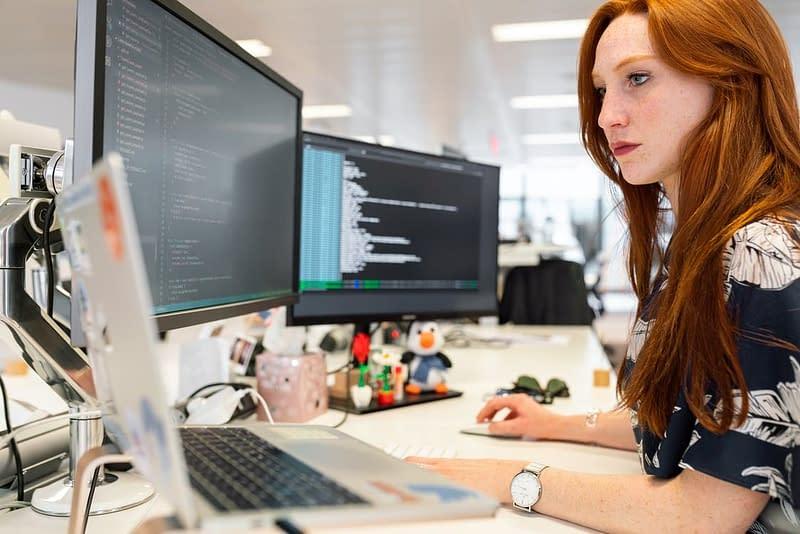 An employee working on an ERP system.
